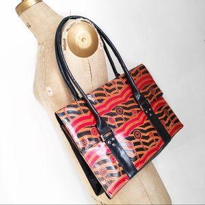 Boho patterned large leather shoulder bag.